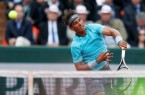 Nadal of Spain serves to Ginepri of the U.S. during their men's singles match at the French Open tennis tournament at the Roland Garros stadium in Paris